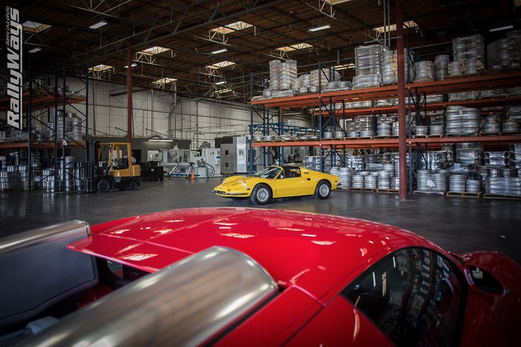 Ferrari 246 Dino GTS in front of a Bugatti Veyron