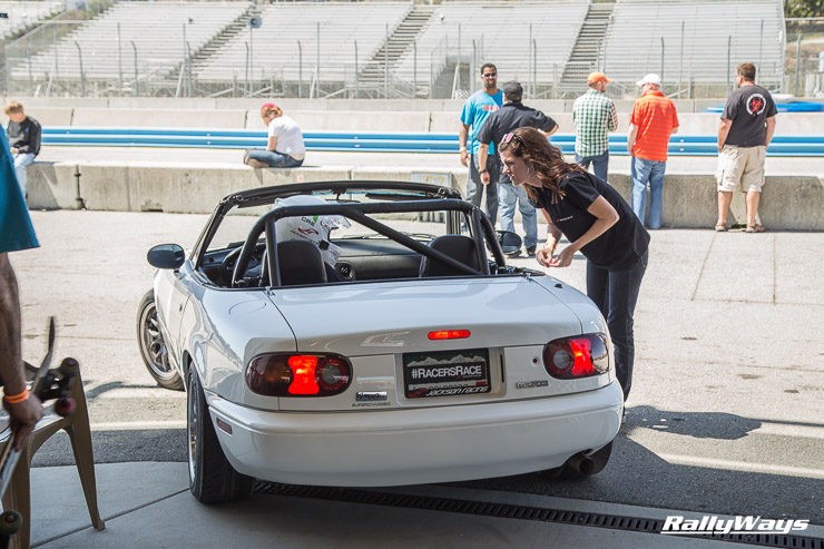 Racer's Edge white Miata leaving the paddock area at MRLS
