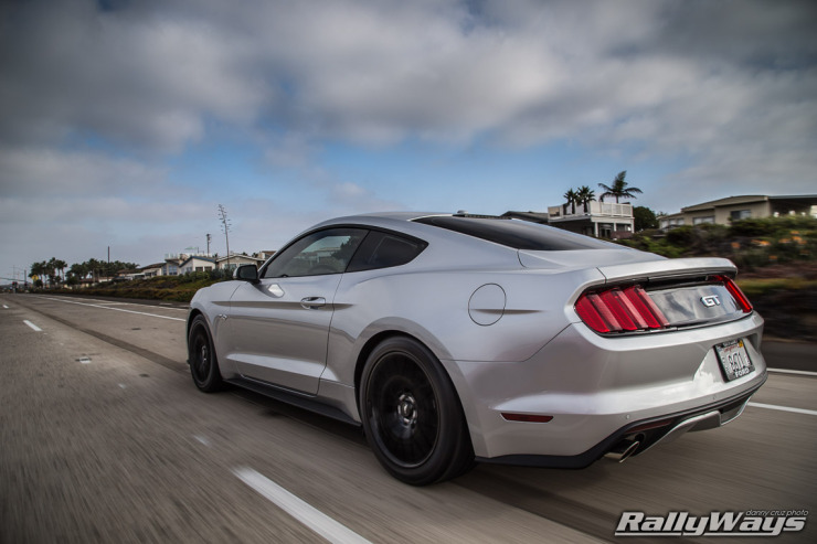 Action photo of the rear of a new 2015 Ford Mustang.